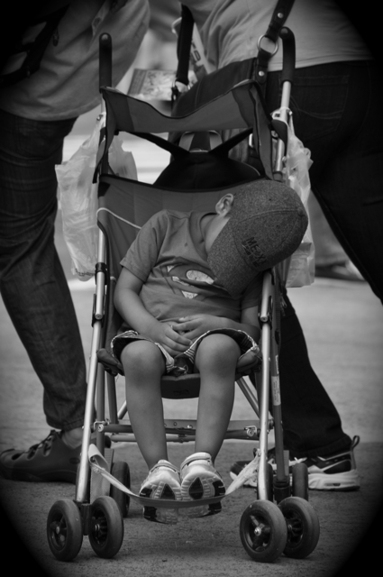 young boy sleeping in his stroller
