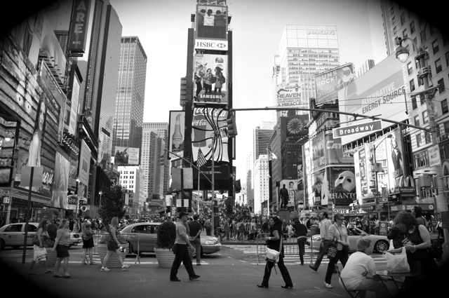 Wide angle shot of Times Square filled with people
