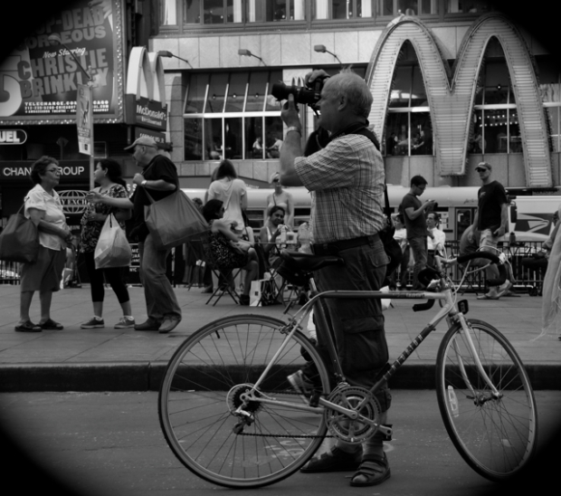 tourist with bike taking a picture