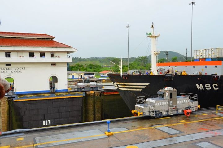 Panama Canal. The Miraflores Locks open to let a ship pass through.