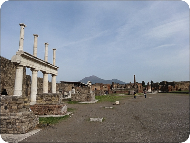 The Forum with Mt. Vesuvius looming in the background, its top blown off during the eruption.