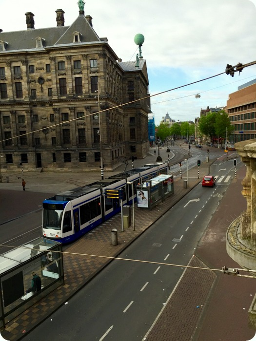 glimpse of the Royal Palace  and street behind Dam Square